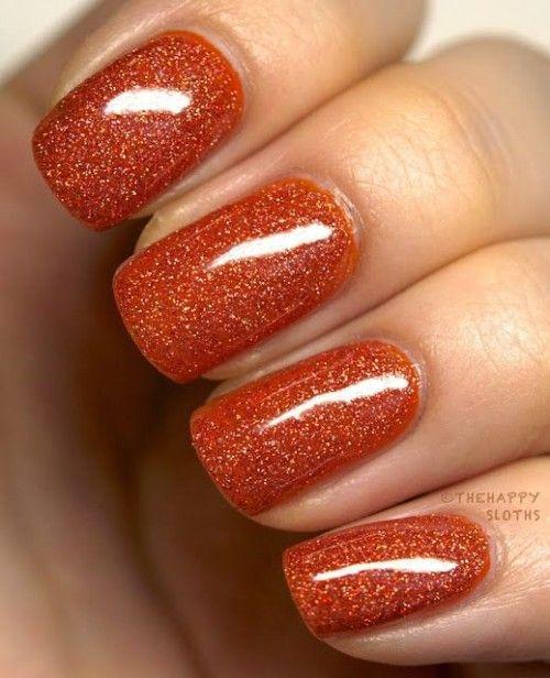 Оранжевый маникюр с блестками